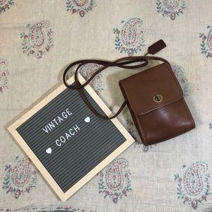 Brown leather Coach mini crossbody